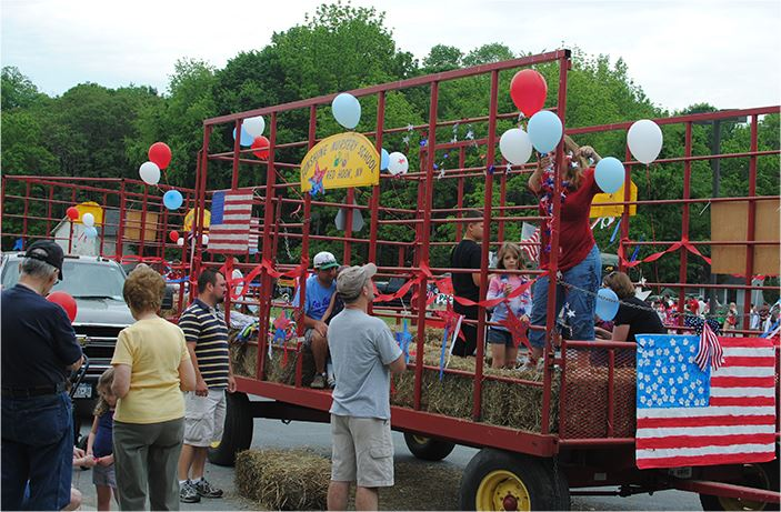 A trailer with people getting ready for a parade
